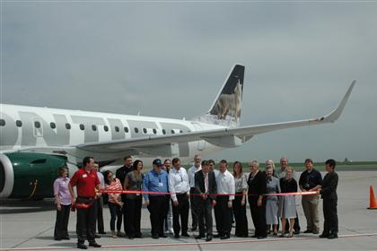 Ribbon Cutting Shot in front of the Aircraft